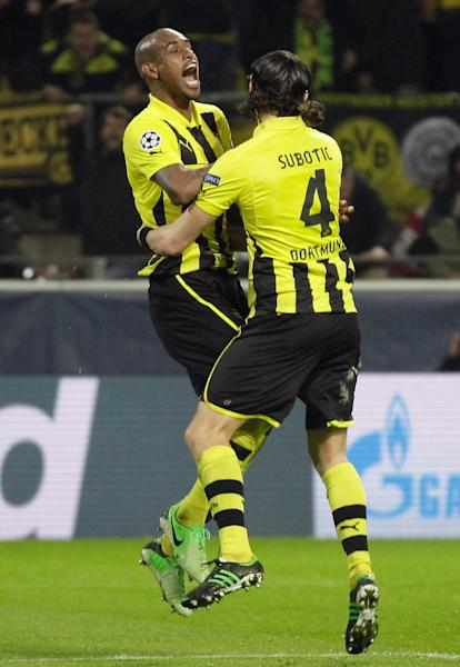 Dortmund's Felipe Santana of Brazil, left, celebrates with Neven Subotic of Serbia after scoring the winning goal during the Champions League quarterfinal second leg soccer match between Borussia Dortmund and Malaga CF in Dortmund, Germany, Tuesday, April 9, 2013. Dortmund defeated Malaga 3-2. (AP Photo/Frank Augstein)