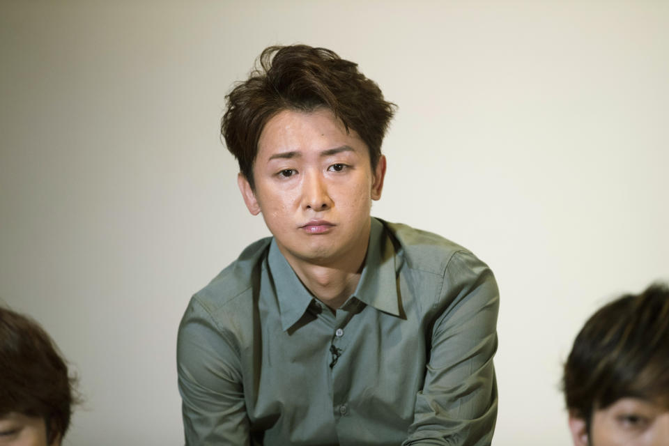 Satoshi Ohno, a member of Japanese pop music band ARASHI, listens to a question during an interview with The Associated Press in Tokyo on Thursday, Sept. 17, 2020. (AP Photo/Hiro Komae)
