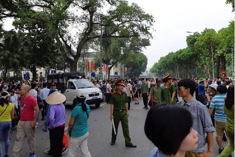 Vietnam detains 100 after protests turn violent