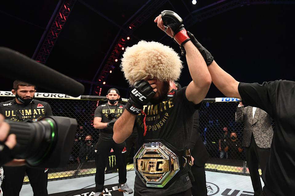 Khabib Nurmagomedov celebrates his victory over Justin Gaethje in their lightweight title bout at UFC 254 on Oct. 25, 2020 in Abu Dhabi, United Arab Emirates. (Josh Hedges/Zuffa LLC via Getty Images)