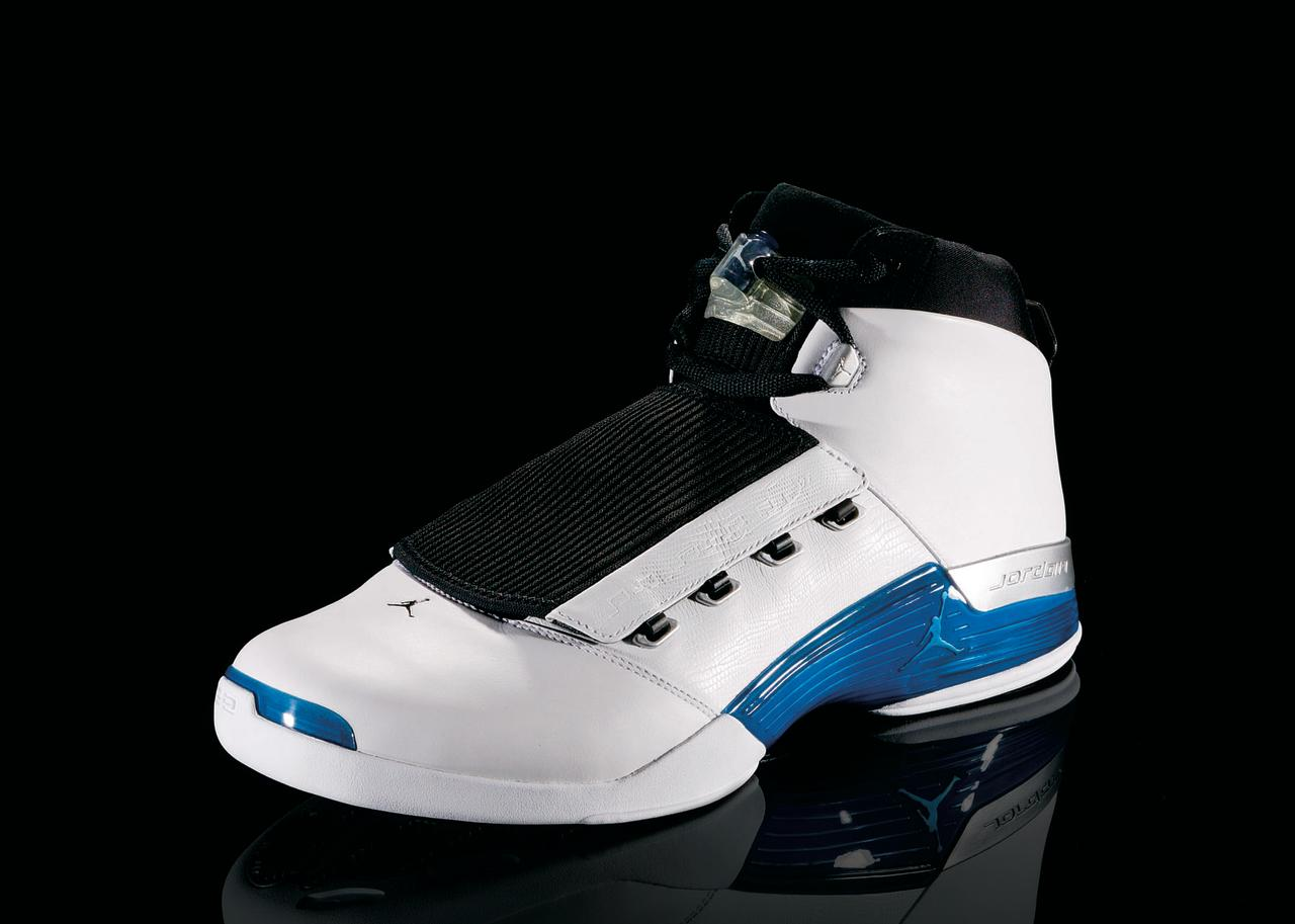 """<p>Air Jordan XVII - """"Jazzed Up"""" (2002): Packaged in a metal briefcase and includes a CD-ROM, this is the shoe MJ wore in his return to the court with the Washington Wizzards. The sole's designed is based on a golf course, an homage to Jordan's retirement. (Photo Courtesy of Nike)</p>"""