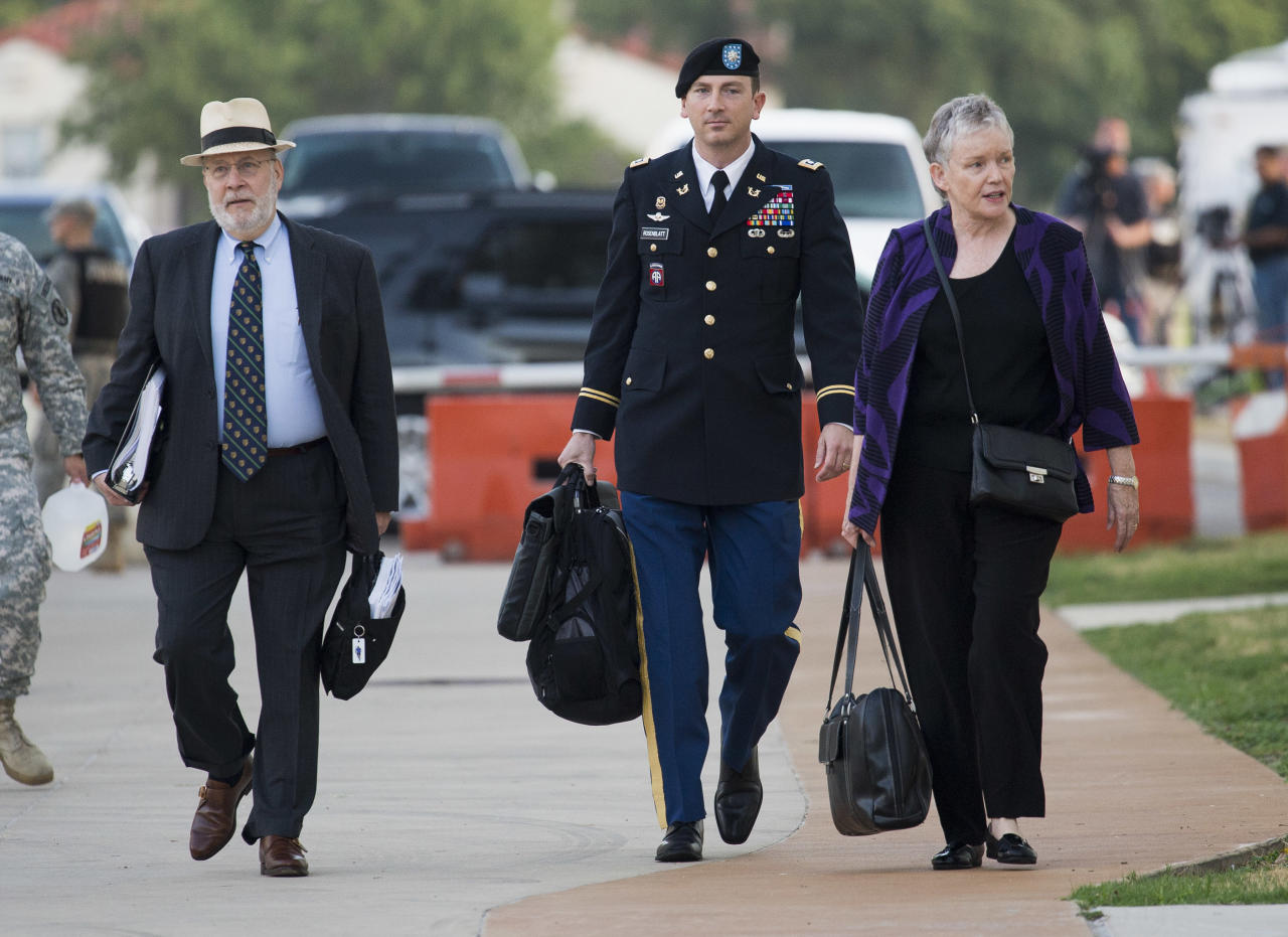 From left, defense lead counsel Eugene Fidell, defense counsel Lt. Col. Franklin D. Rosenblatt, and Dr. Mary Connell, consultant for the defense, arrive for day two of a preliminary hearing to determine if Army Sgt. Bowe Bergdahl will be court-martialed, Friday, Sept. 18, 2015, at Fort Sam Houston, Texas. Bergdahl, who left his post in Afghanistan and was held by the Taliban for five years, is charged with desertion and misbehavior before the enemy. (AP Photo/Darren Abate)