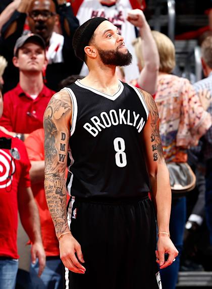 Deron Williams reacts after missing a basket in the final seconds of Game 2. (Kevin C. Cox/Getty Images)