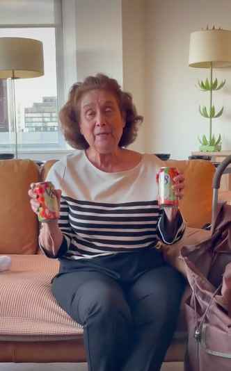 grandma sheila is holding up v8 cans