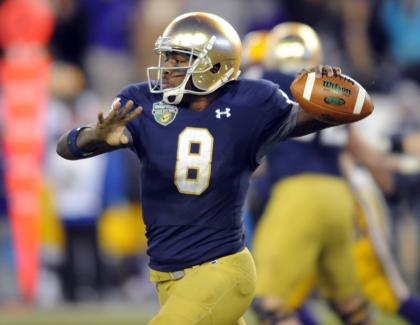 Dec 30, 2014; Nashville, TN, USA; Notre Dame Fighting Irish quarterback Malik Zaire (8) passes during the second half against the LSU Tigers in the Music City Bowl at LP Field. Notre Dame won 31-28. (Christopher Hanewinckel-USA TODAY Sports)