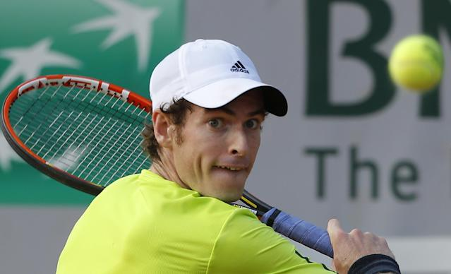 Britain's Andy Murray returns the ball during the fourth round match of the French Open tennis tournament against Spain's Fernando Verdasco at the Roland Garros stadium, in Paris, France, Monday, June 2, 2014. Murray won in three sets 6-4, 7-5, 7-6. (AP Photo/Michel Euler)