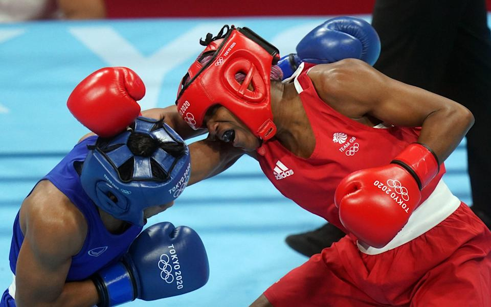 Caroline Dubois of Great Britain (right) and Sudaporn Seesondee of Thailand during the Women's Light (57-60kg) Quarter final 2 at the Kokugikan Arena on the eleventh day of the Tokyo 2020 Olympic Games in Japan - PA