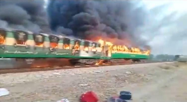 A fire burns a train carriage after a gas canister passengers were using to cook breakfast exploded, near the town of Rahim Yar Khan in the south of Punjab province, Pakistan October 31, 2019, in this still image take from video. REUTERS/Asghar Bhawalpuri/via REUTERS TV
