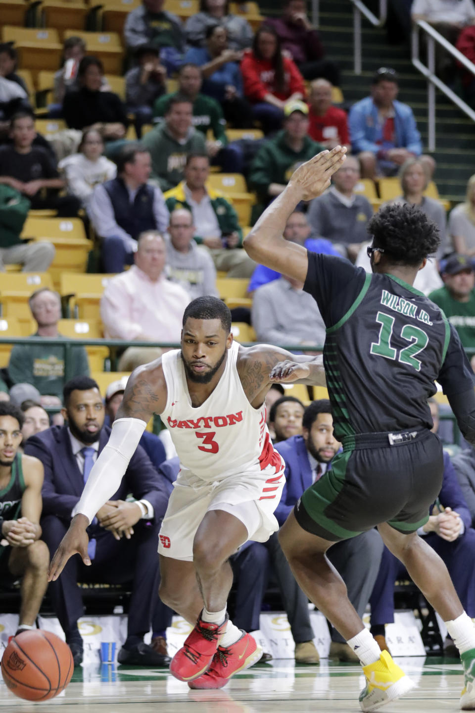 Dayton's Trey Landers (3) moves the ball on George Mason's AJ Wilson (12) during the first half of an NCAA college basketball game, Tuesday, Feb. 25, 2020, in Fairfax, Va. (AP Photo/Luis M. Alvarez)