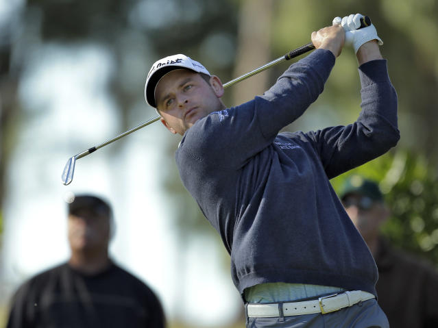 John Merrick follows the flight of his tee shot on the eighth hole during the first round of the Valspar Championship golf tournament at Innisbrook, Thursday, March 13, 2014, in Palm Harbor, Fla. (AP Photo/Chris O'Meara)