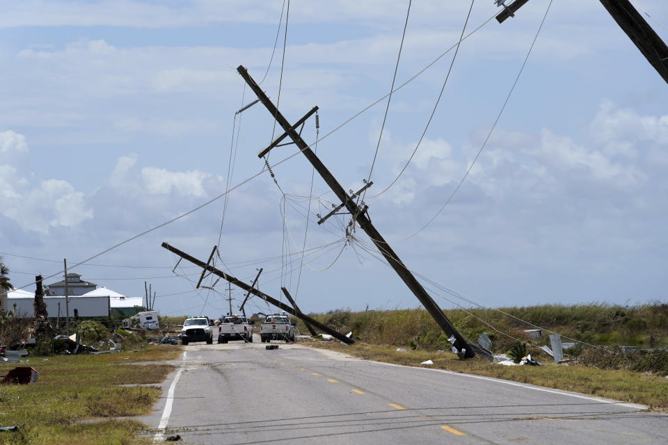 Broken electrical poles are seen in Holly Beach, La., in the aftermath of Hurricane Laura, Saturday, Aug. 29, 2020. (AP Photo/Gerald Herbert)