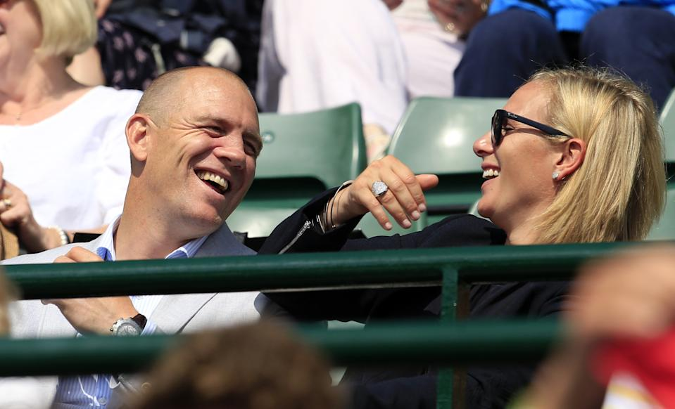 Zara Phillips and Mike Tindall can't control their laughter as they enjoy some centre court action on day nine of the 2015 tournament. <em>[Photo: PA]</em>