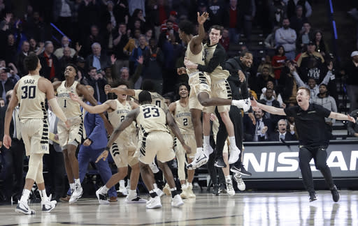 Wake Forest players celebrate after defeating North Carolina State 71-67 in an NCAA college basketball game in Winston-Salem, N.C., Tuesday, Jan. 15, 2019. (AP Photo/Chuck Burton)