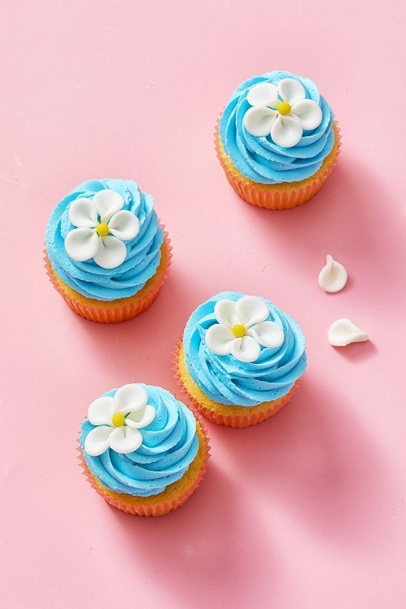 "<p>Skip a fresh bouquet, and opt for these edible spring flower cupcakes. Everyone will love these beautiful blooms.</p><p><em><a href=""https://www.goodhousekeeping.com/food-recipes/dessert/a30809974/flower-cupcake-recipe/"" rel=""nofollow noopener"" target=""_blank"" data-ylk=""slk:Get the recipe for Blue Flower Cupcakes »"" class=""link rapid-noclick-resp"">Get the recipe for Blue Flower Cupcakes »</a></em> </p>"