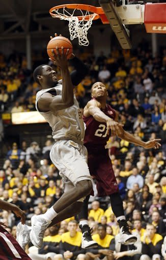 Wichita State's Ehimen Orukpe, left, shoots a layup against Southern Illinois' Josh Swan (21) during the second half of their NCAA college basketball game, Wednesday, Jan. 9, 2013, in Wichita, Kan. Wichita State won 82-76. (AP Photo/The Wichita Eagle, Fernando Salazar)