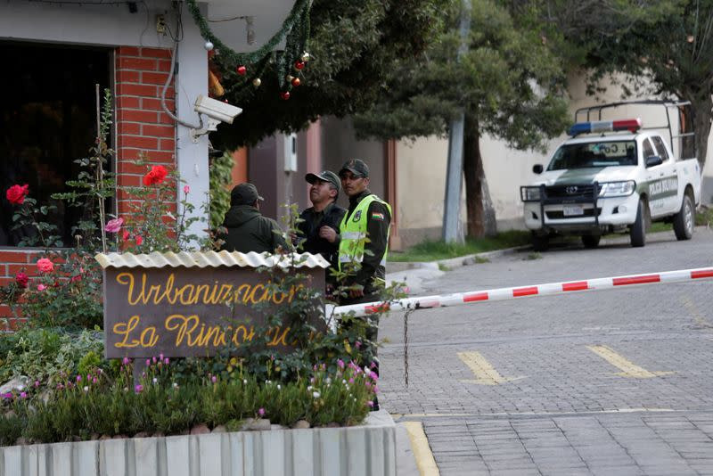 Policemen are seen at the entrance of the Urbanizacion La Rinconada, where the residence of Mexico's ambassador is located, in La Paz