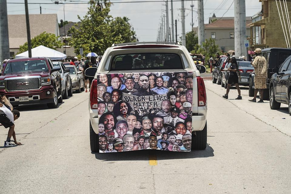 A Black Lives Matter banner is seen on the back of a pickup truck during Juneteenth Parade in Galveston, Texas.