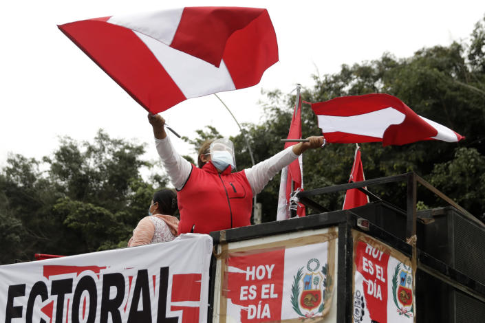 A supporter of presidential candidate Keiko Fujimori waves banners during a protest against alleged election fraud, in Lima, Peru, Saturday, June 12, 2021. Supporters are hoping to reverse the results of the June 6th presidential runoff election that seem to have given the win to opponent Pedro Castillo amid unproven claims of possible vote tampering. (AP Photo/Guadalupe Pardo)