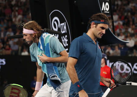 Tennis - Australian Open - Fourth Round - Melbourne Park, Melbourne, Australia, January 20, 2019. Switzerland's Roger Federer and Greece's Stefanos Tsitsipas during the match. REUTERS/Aly Song