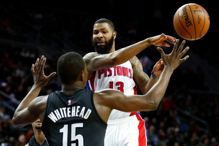 Marcus Morris of the Detroit Pistons passes to a teammate around Isaiah Whitehead of the Brooklyn Nets during the first half, at the Palace of Auburn Hills in Michigan, on March 30, 2017