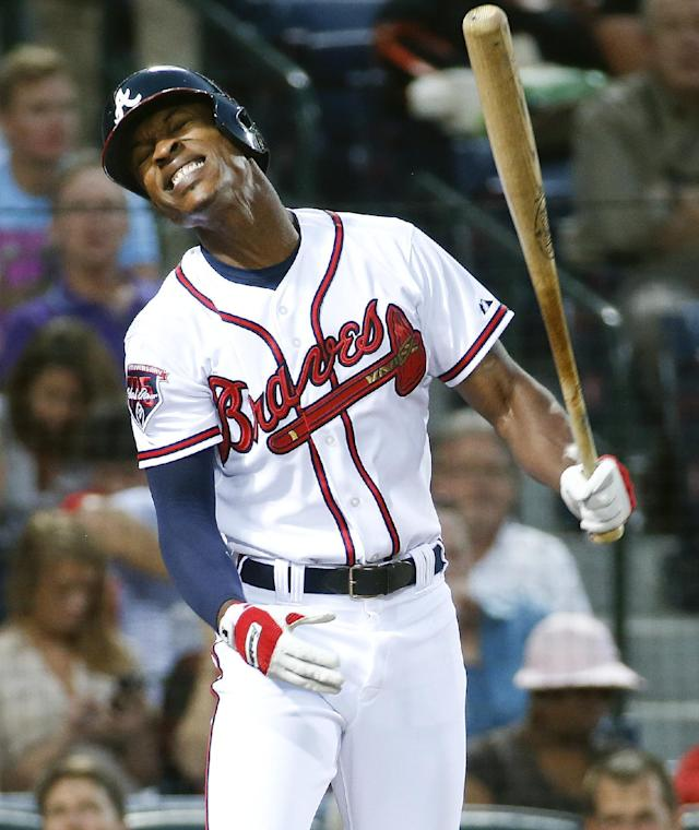Atlanta Braves center fielder B.J. Upton reacts after striking out in the third inning of a baseball game against the Miami Marlins Monday, April 21, 2014 in Atlanta. (AP Photo/John Bazemore)