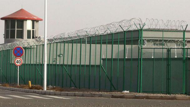 PHOTO: In this Dec. 3, 2018, file photo, a guard tower and barbed wire fence surround a detention facility in the Kunshan Industrial Park in Artux in western China's Xinjiang region. (Ng Han Guan/AP, FILE)