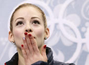 Gracie Gold of the United States blows a kiss to spectators as she waits in the results area after completing her routine in the women's short program figure skating competition at the Iceberg Skating Palace during the 2014 Winter Olympics, Wednesday, Feb. 19, 2014, in Sochi, Russia. (AP Photo/Bernat Armangue)