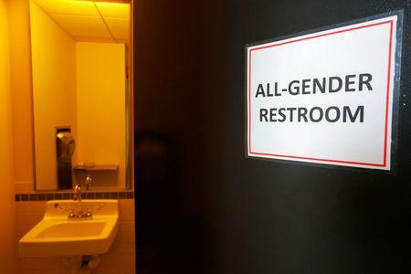 """A sign marks an """"All-Gender Restroom"""" at the Radcliffe Institute for Advanced Study at Harvard University in Cambridge, Massachusetts, U.S. May 13, 2016. REUTERS/Brian Snyder"""