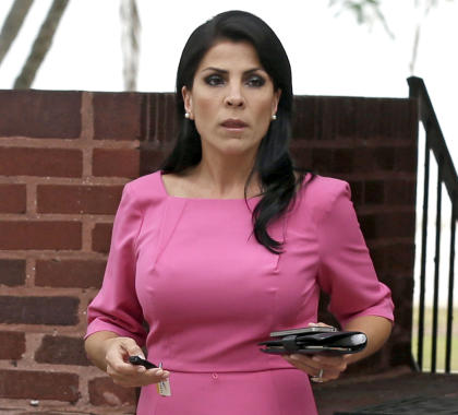 In this Nov. 13, 2012, file photo, Jill Kelley leaves her home in Tampa, Fla. U.S. District Judge Amy Berman Jackson says Jill Kelley can press her claim that the FBI and Defense Department violated her privacy when officials allegedly leaked information about her to the news media. Berman also tossed out more than a dozen other claims of government wrongdoing. (AP Photo/Chris O'Meara, File)