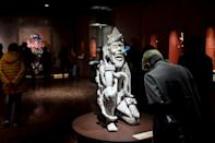 """A visitor looks at a sculpture called """"El Creador"""" at the """"Greatness of Mexico"""" exhibition at the National Museum of Anthropology in the Mexican capital (AFP/Pedro PARDO)"""