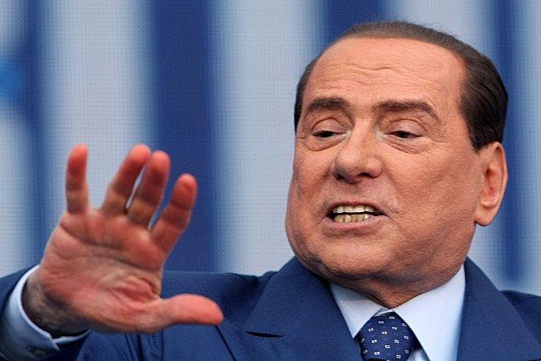 Former Italian prime minister Silvio Berlusconi gives a speech in Bari, on April, 13, 2013