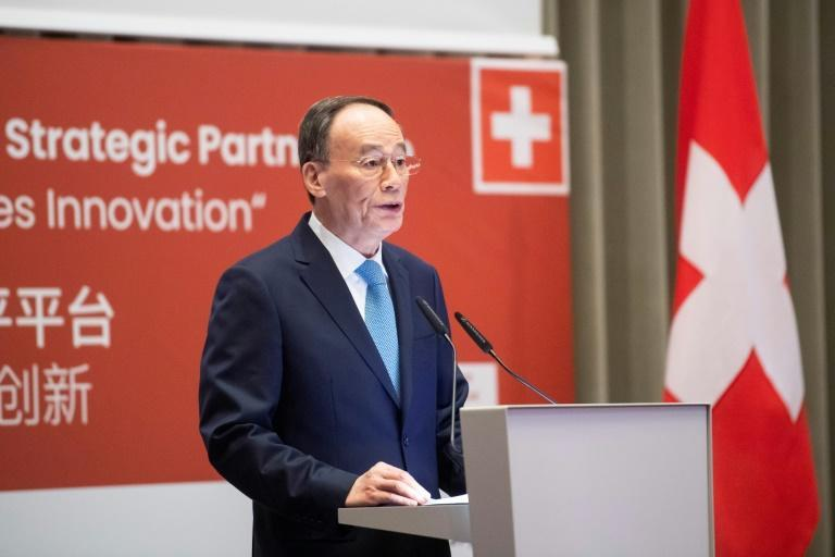 Chinese Vice President Wang Qishan, tasked with negotiating a truce in the US-China trade war, gets top billing in Davos, where the US government shutdown means Washington has no delegation