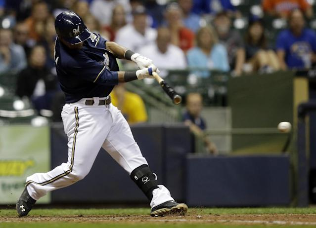 Milwaukee Brewers' Jean Segura hits an RBI single during the eighth inning of a baseball game against the Pittsburgh Pirates Tuesday, Sept. 3, 2013, in Milwaukee. (AP Photo/Morry Gash)