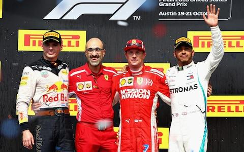 Race winner Kimi Raikkonen of Finland and Ferrari, second placed Max Verstappen of Netherlands and Red Bull Racing and third placed Lewis Hamilton of Great Britain and Mercedes GP celebrate on the podium during the United States Formula One Grand Prix at Circuit of The Americas on October 21, 2018 in Austin, United States - Credit: getty images