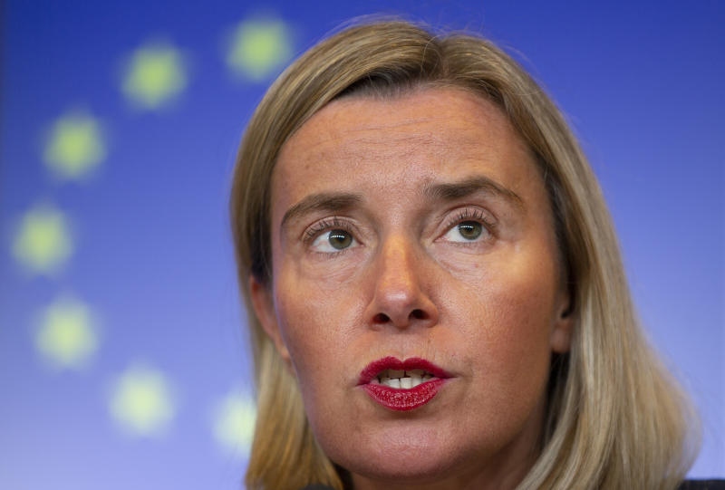 European Union foreign policy chief Federica Mogherini speaks during a media conference at the conclusion of a meeting of EU foreign ministers at the European Convention Center in Luxembourg, Monday, Oct. 14, 2019. Some European Union nations are looking to extend moves against Turkey by getting more nations to ban arms exports to Ankara to protest the offensive in neighboring Syria. (AP Photo/Virginia Mayo)