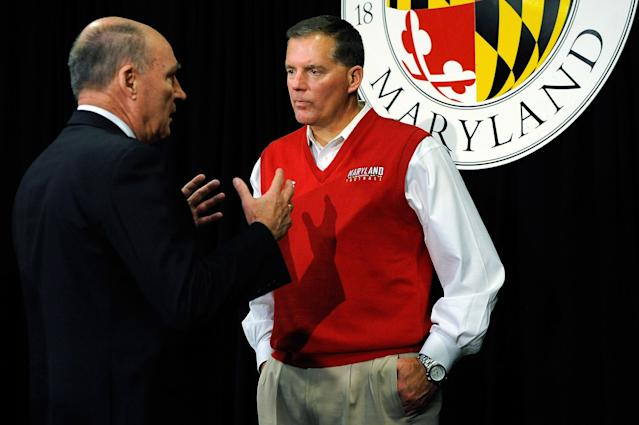 COLLEGE PARK, MD - NOVEMBER 19: Big Ten Commissioner James E. Delany (L) speaks with University of Maryland football head coach Randy Edsall after a news conference annoucing Maryland's decision to join the Big Ten Conference on November 19, 2012 in College Park, Maryland. (Photo by Patrick McDermott/Getty Images)