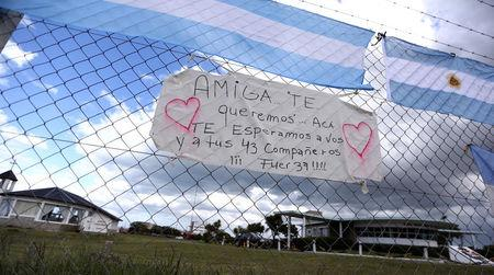 "A sign in support of Maria Krawczyk, a submarine officer on board the Argentine navy submarine ARA San Juan, which went missing in the South Atlantic, and for the other 43 crew members is displayed on a fence outside the Argentine Naval Base where the submarine sailed from in Mar del Plata, Argentina November 20, 2017. The sign reads: ""Girlfriend, we love you and we wait for you and your 43 mates. Be strong!"" REUTERS/Marcos Brindicci"