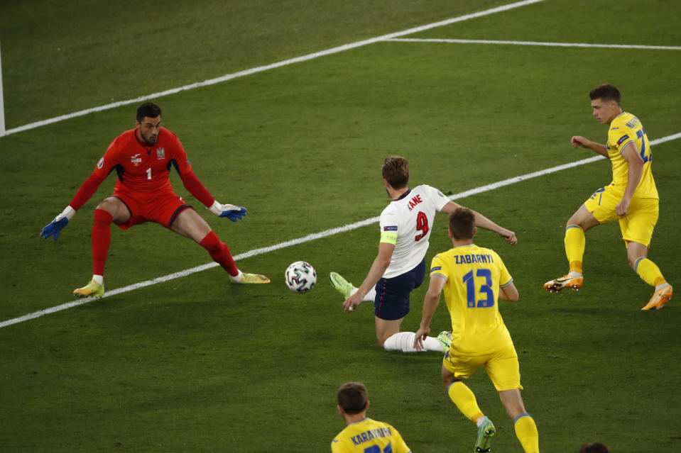 England's Harry Kane, center, scores his side's opening goal during the Euro 2020 soccer championship quarterfinal match between Ukraine and England at the Olympic stadium in Rome, Italy, Saturday, July 3, 2021. (Alessandro Garofalo/Pool Via AP)