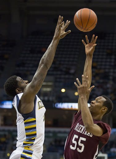 Marquette's' Jamil Wilson defends as North Carolina Central's Ray Willis shoots the ball during the second half of an NCAA college basketball game, Saturday, Dec. 29, 2012, in Milwaukee. (AP Photo/Tom Lynn)