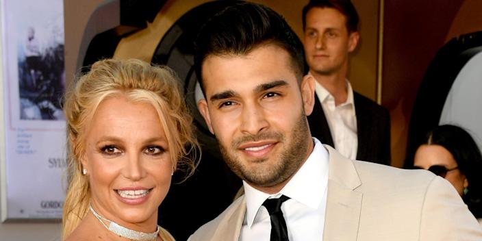 """Britney Spears (L) and Sam Asghari arrive at the premiere of Sony Pictures' """"One Upon A Time...In Hollywood"""""""