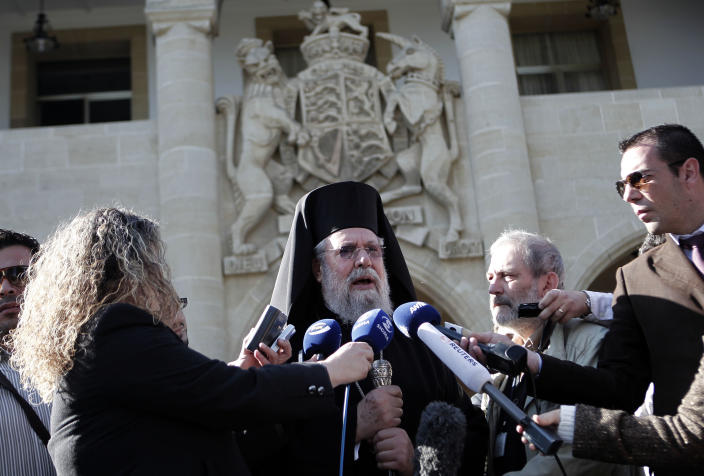 Cypriot Archbishop Chrysostomos II speaks to the media outside Presidential Palace after his meeting with Cypriot president Nicos Anastasiades, in Nicosia, Wednesday, March 20, 2013. Following the talks with President Anastasiades, the head of Cyprus' influential Orthodox church Archbishop Chrysostomos II said on Wednesday that he will put the church's assets at the country's disposal to help pull it out of a financial crisis. Cypriot lawmakers have rejected a critical draft bill that would have seized part of people's bank deposits in order to qualify for a vital international bailout. (AP Photo/Petros Giannakouris)
