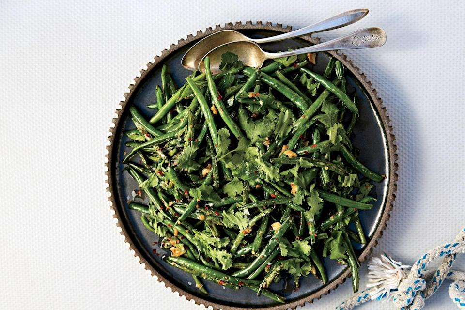 "Don't rush to shake the pan and toss the green beans before they blister; they need a little time to char. This green bean recipe would be splendid alongside some <a href=""https://www.epicurious.com/expert-advice/best-grilled-chicken-recipes-for-summer-and-fall-gallery?mbid=synd_yahoo_rss"" rel=""nofollow noopener"" target=""_blank"" data-ylk=""slk:grilled chicken"" class=""link rapid-noclick-resp"">grilled chicken</a>. <a href=""https://www.epicurious.com/recipes/food/views/blistered-green-beans-with-garlic-and-miso?mbid=synd_yahoo_rss"" rel=""nofollow noopener"" target=""_blank"" data-ylk=""slk:See recipe."" class=""link rapid-noclick-resp"">See recipe.</a>"