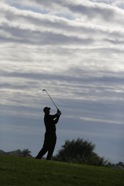 Tiger Woods watches his shot after teeing off the fifth tee during the third round of the Honda Classic golf tournament, Saturday, March 2, 2013 in Palm Beach Gardens, Fla. (AP Photo/Wilfredo Lee)