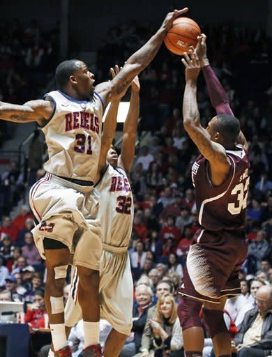 Mississippi forward Murphy Holloway (31) blocks a pass by Mississippi State guard Craig Sword, right, while Mississippi's Jarvis Summers assists on defense during the first half of an NCAA college basketball game in Oxford, Miss., Wednesday, Feb. 6, 2013. (AP Photo/Rogelio V. Solis)