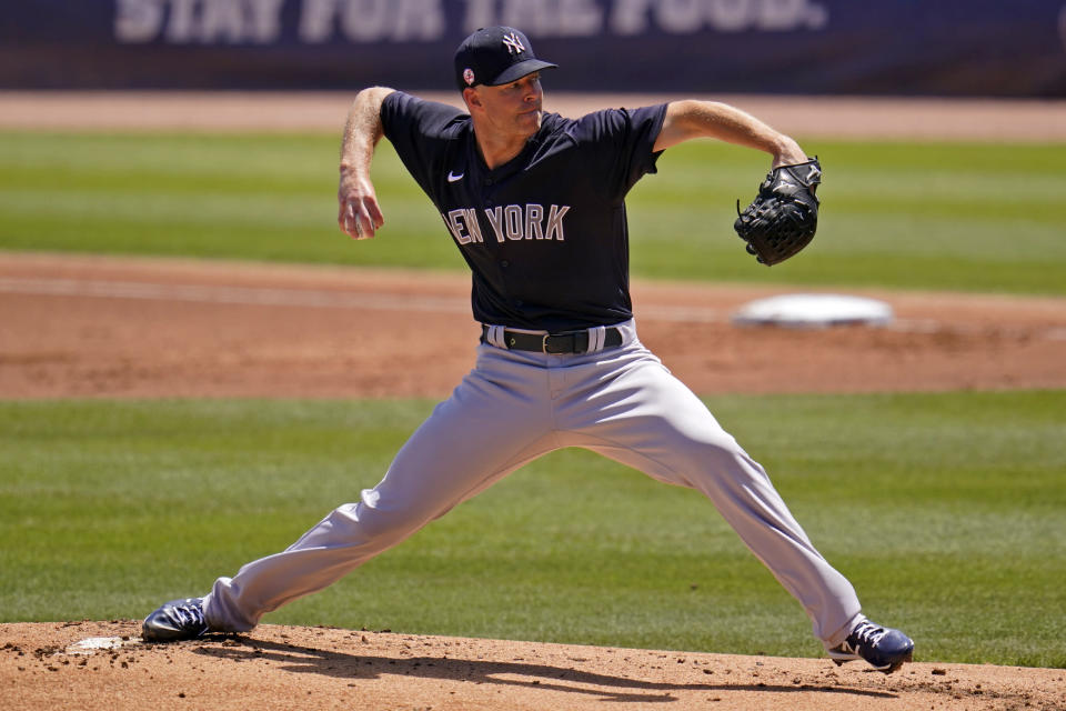New York Yankees starting pitcher Corey Kluber delivers during the second inning of a spring training exhibition baseball game against the Philadelphia Phillies in Clearwater, Fla., Sunday, March 28, 2021. (AP Photo/Gene J. Puskar)