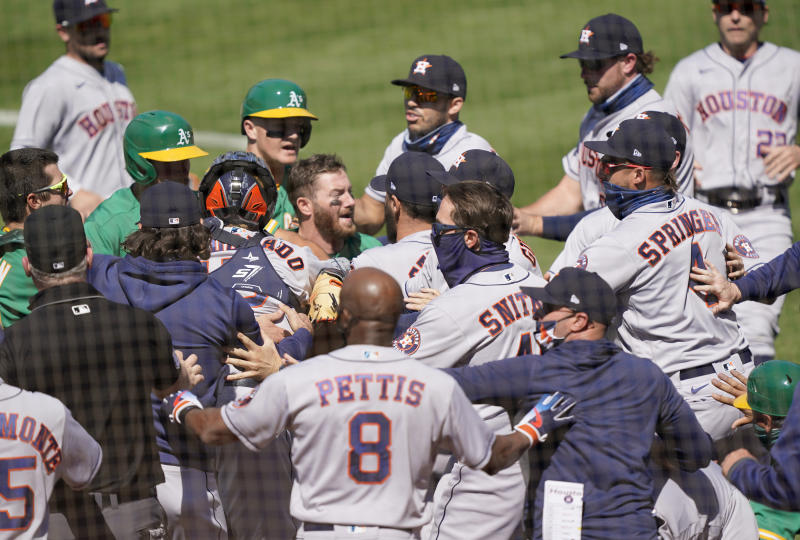 OAKLAND, CALIFORNIA - AUGUST 09: Players from the Houston Astros and Oakland Athletics get into a shoving match after Ramon Laureano #22 of the Athletics was hit by a pitch and charged into the Astros dugout in the bottom of the seventh inning at RingCentral Coliseum on August 09, 2020 in Oakland, California. (Photo by Thearon W. Henderson/Getty Images)