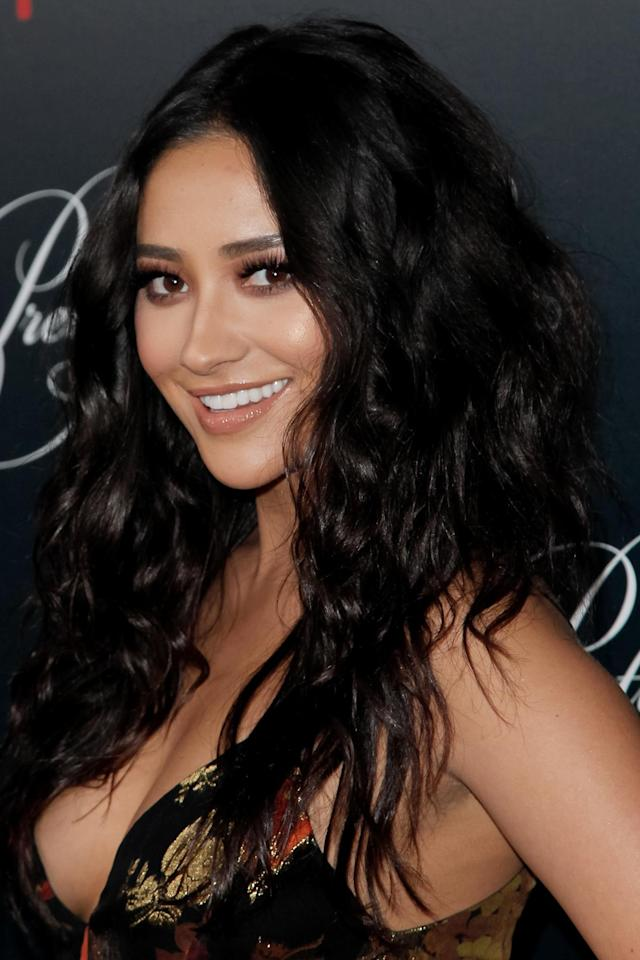 <p>Mitchell attended the celebration for the final season of <em>Pretty Little Liars</em> rocking curly hair and a bronzed beauty look. (Photo: Getty Images) </p>