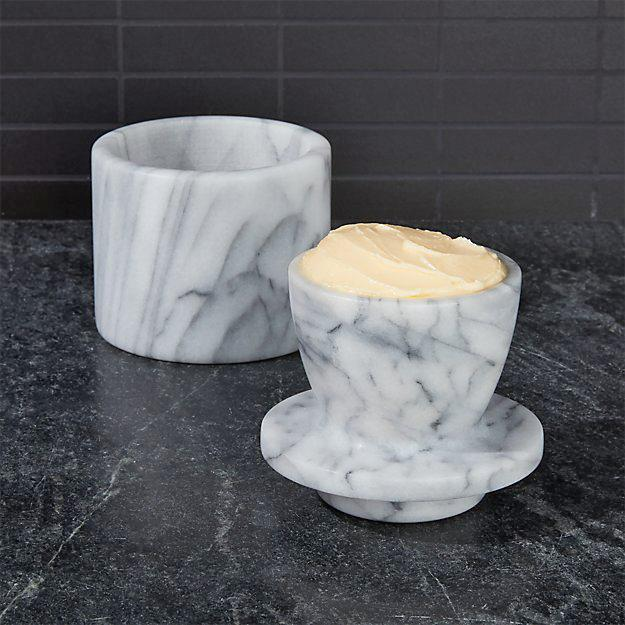 """<p>Cool and elegant, this marble butter keeper holds eight ounces of butter. It's a bit more delicate than other options, so you'll need to wash it by hand.</p> <p><em><strong>Shop Now:</strong> Crate & Barrel French Kitchen Marble Butter Keeper, $24.95, <a href=""""http://www.anrdoezrs.net/links/7799179/type/dlg/sid/MSLWhyEveryHomeCookShouldOwnaButterCrockPlusOurFavoriteOptionsontheMarketRightNowvspence2FooGal7844477202007I/https://www.crateandbarrel.com/french-kitchen-marble-butter-keeper/s116933"""" rel=""""nofollow noopener"""" target=""""_blank"""" data-ylk=""""slk:crateandbarrel.com"""" class=""""link rapid-noclick-resp"""">crateandbarrel.com</a>.</em></p>"""