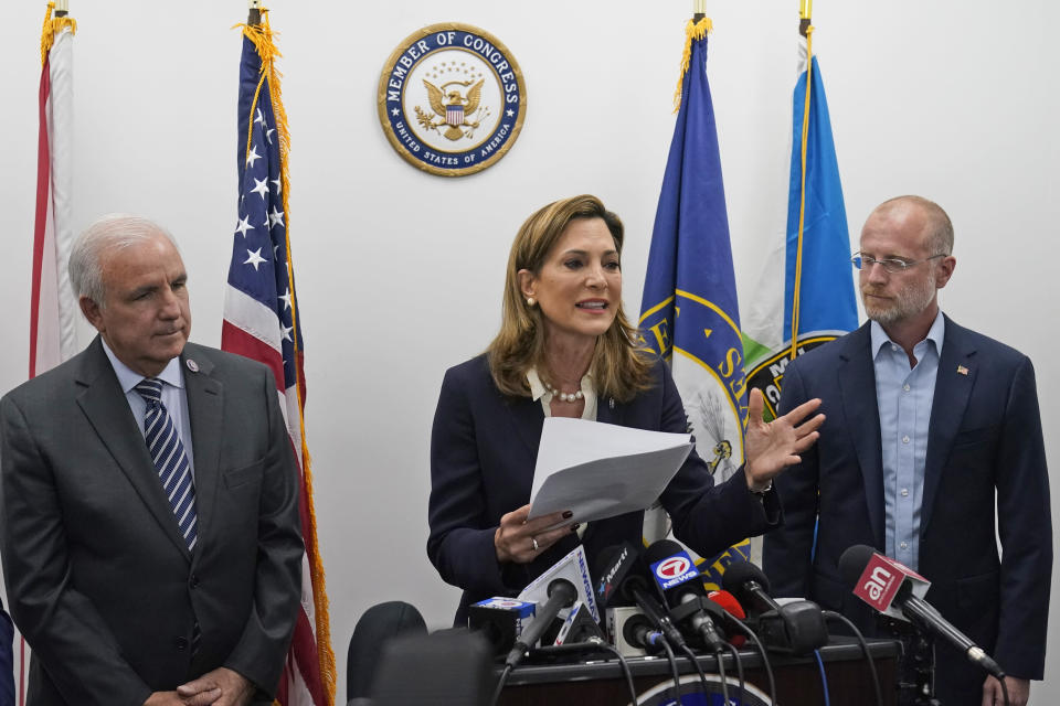Rep. Maria Elvira Salazar, center, R-Fla., speaks alongside Rep. Carlos Gimenez, left, R-Fla., and Federal Communications Commissioner Brendan Carr, right, Thursday, July 15, 2021, in Miami. Florida Gov. Ron DeSantis and other officials pressed the White House on Thursday to support efforts to preserve internet service to antigovernment protesters in Cuba, even advocating the use of giant balloons as floating Wi-Fi hotspots to allow images of dissent to stream unabated from the authoritarian nation. (AP Photo/Wilfredo Lee)
