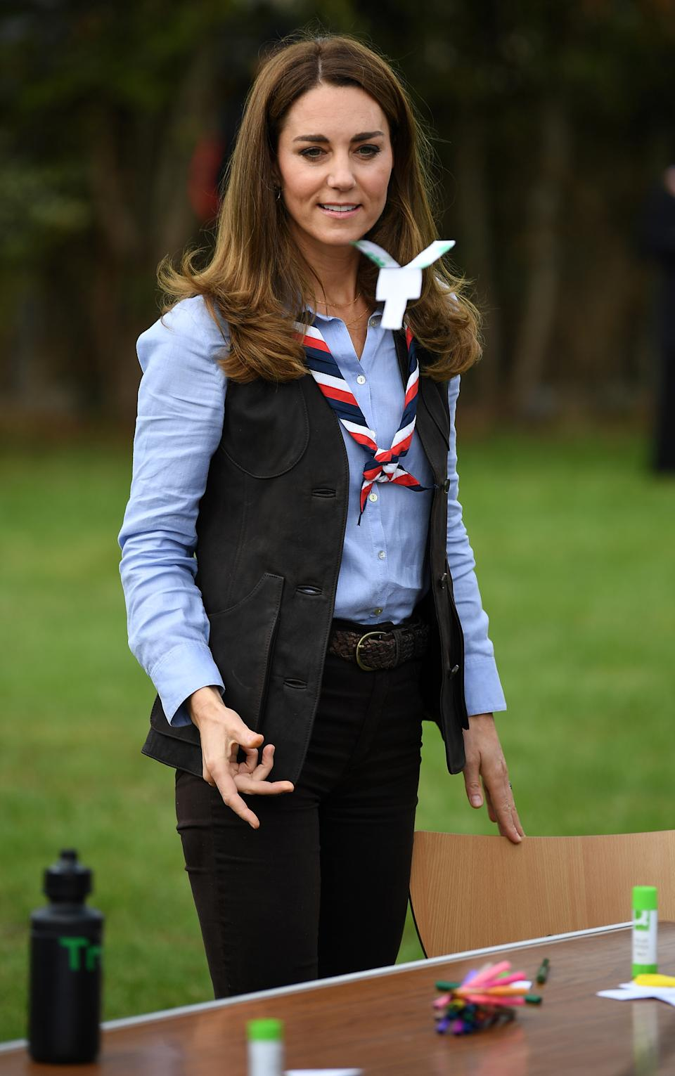 LONDON, ENGLAND - SEPTEMBER 29: Catherine, Duchess of Cambridge plays with a paper toy as she visits with members of the Beavers as she visits a Scout Group in Northolt, northwest London where she joined Cub and Beaver Scouts in outdoor activities on September 29, 2020 in London, England. The Duchess learned how the Scouts have adapted during the COVID-19 pandemic, and continued Scouting sessions and online activities. (Photo by Daniel Leal-Olivas - WPA Pool/Getty Images)